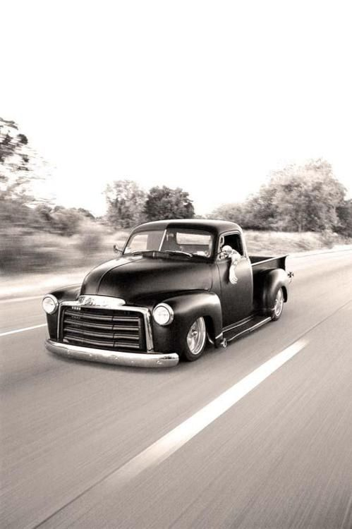 Some awesomely lowered Chevrolet pickup.
