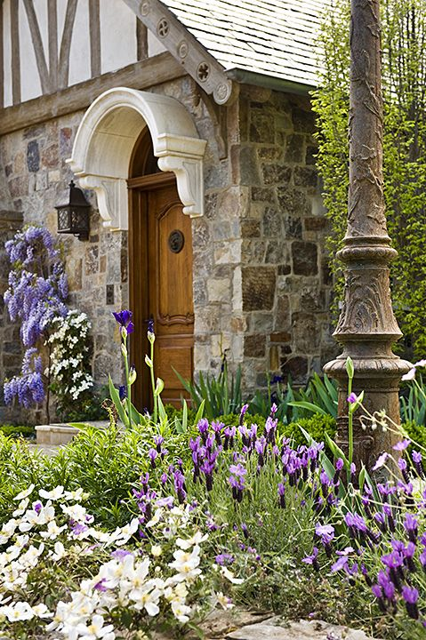 Nice, France - Garden entrance with antique lamp post from