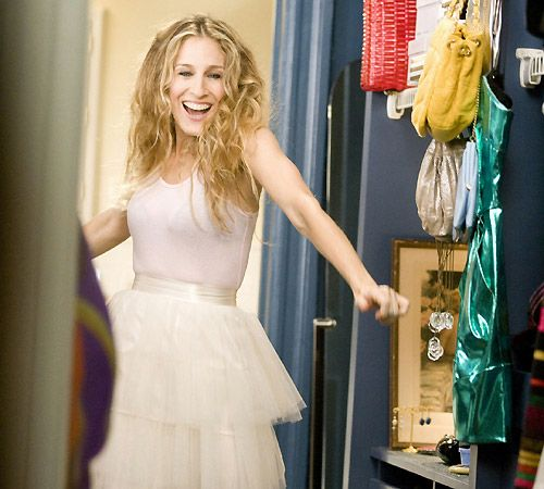 "i love carrie bradshaw in ""sex and the city"": her adventures in new york city, her mix of over the top glamour and casual. (and that skirt!)"