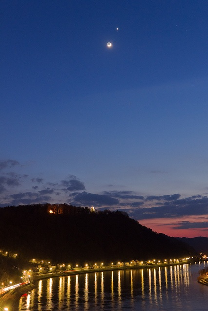 Conjunction over the Danube    The cerscent, waxing Moon meets the Planets Venus and Jupiter over the banks of the Danube river in Linz, Austria. See this panoramic view and this closeup of the Moon and Venus, both taken at the same evening. March 26 2012