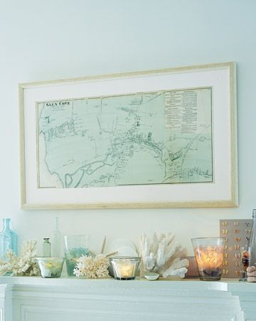 Love this beach decor.... pretty beachy blue, candles, bottles, shells and framed map x