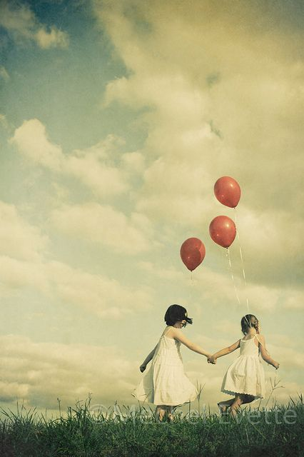 Sweet picture of sisters with balloons. Love this.