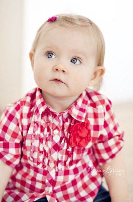 baby girl in red white check shirt