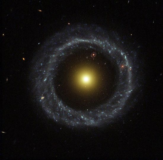 Hoag's Object by NASA:  This  non-typical galaxy is known as a ring galaxy, and was discovered in 1950 by astronomer Art Hoag, who initially thought it to be a planetary nebula. Serendipitously, from the perspective of our solar system what appears to be an even more distant ring galaxy is plainly visible within the gap between this galaxy's central body of mostly yellow stars and the outer ring of blue stars. via wikipedia. #Ring_Galaxy #Hogs_Object #Astronomy