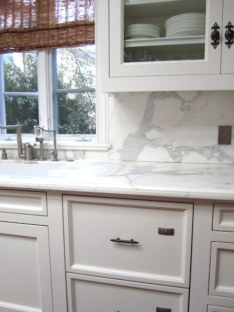 love warm cabinets with marble