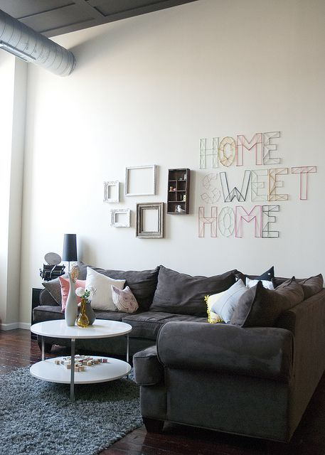 I love the string words on the wall with the small cluster of pictures beside it. For our new livingroom?