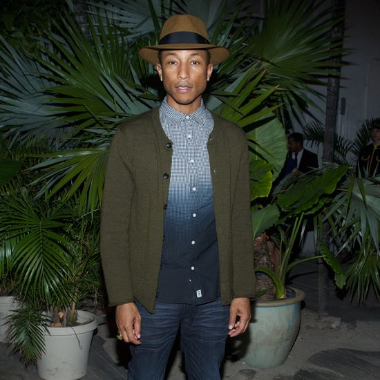 Pharrell Williams at the Louis Vuitton dinner celebrating the realization of La Maison au Bord de l'Eau for Design Miami 2013.
