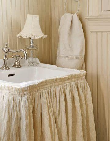 a skirted bathroom sink seems sooooo chic...