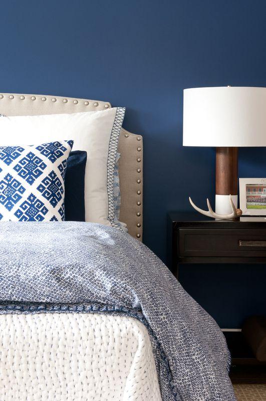 navy walls, layered textiles #navy #bedroom