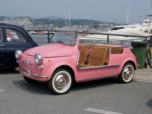 pink car with rattan seats