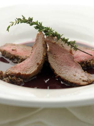 Mushroom-Crusted Lamb Loin with Red Wine Glaze - use a nice bottle of Perrin Réserve Red for this and have the rest with your meal. (or while you're cooking!)