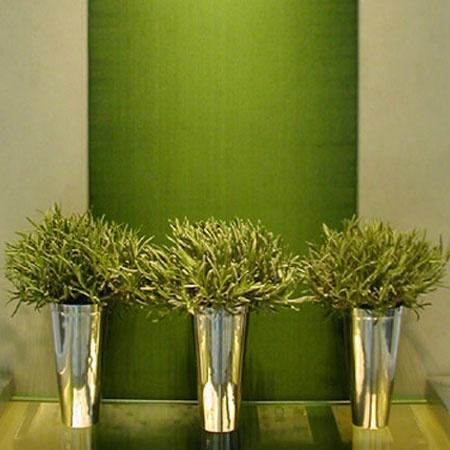 A  row of identical flower arrangements have great impact - Anoushka Hempel