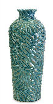 IMAX Lotus Leaves Vase, Large by IMAX. $66.00. Wipe clean with damp cloth. Variegated shades of blue. Beautifully textured ceramic vase. Subtle leaf detail. Lotus Leaves Large Vase, This collection of beautifully textured ceramic vases in variegated shades of blue feature a subtle leaf pattern and are available in three sizes.. Save 12%!