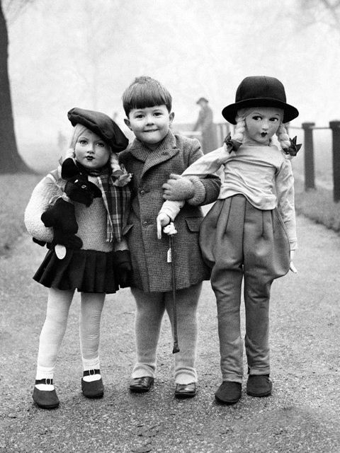 vintage photo - boy with two life-size dolls
