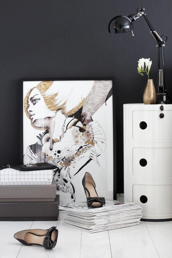 Black wall, white bedding, gold touches