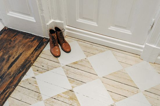 white squares painted on wood floors