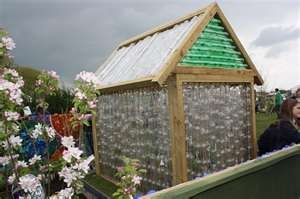 A greenhouse from plastic bottle!  Reduce, reuse, recycle...