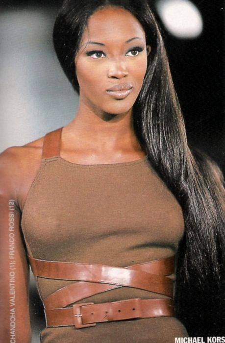 Naomi Campbell for Michael Kors. interesting top... looks like the belt continues up to... what's that called... olkanauha. Axelband. Shoulder band? Doesn't sound right... what ever.