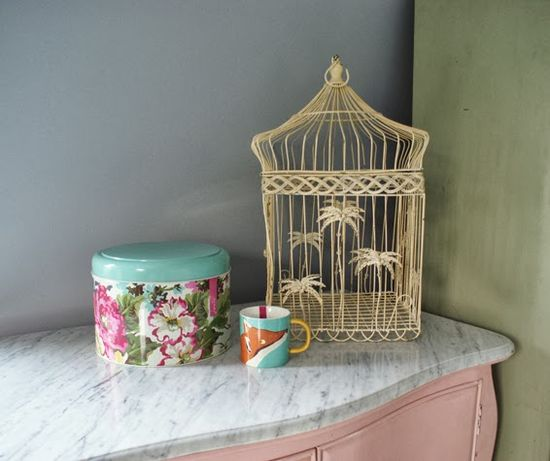 Birdcages and retro cake tins. Perfect bedroom decor :)