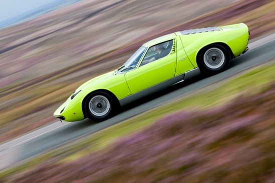 1971 Lamborghini Miura SV: The first midengine supercar. Gave Enzo Ferrari the vapors. Details like lay-flat headlights, intake strakes built into the doors and a roof that finishes in black slats instead of a window are still extreme.