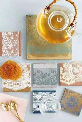 tile coasters spray painted with lace as a stencil