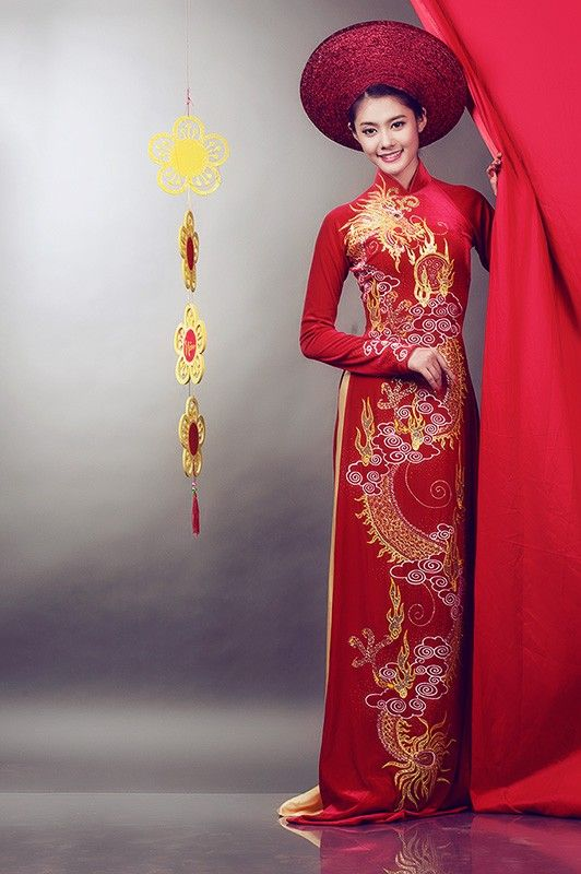 Take the dragon design and put it on blue for the groom's ao dai