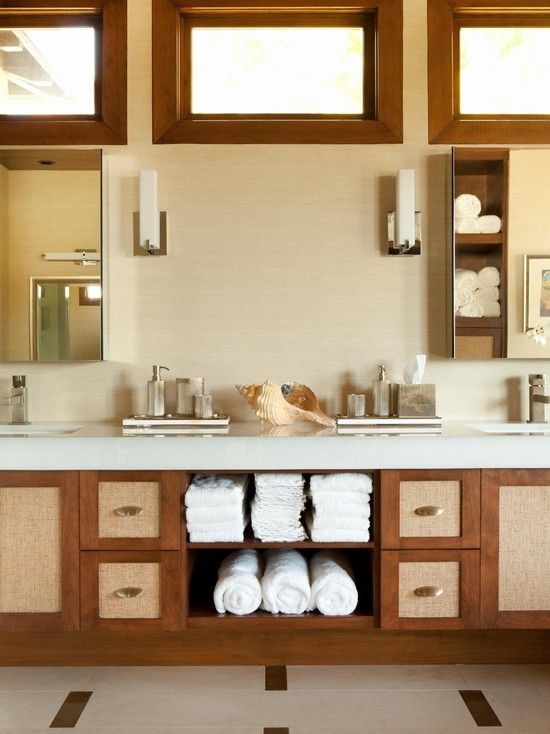 Warm #coastal #bathroom #design with white #towels and seaside #accessories