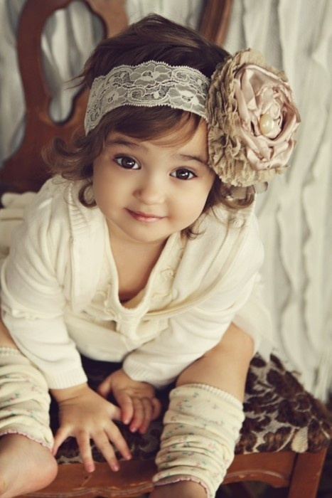 cute baby girl in cream dress