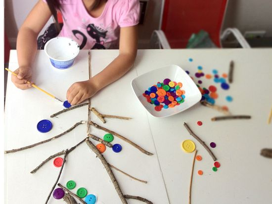 Sticks + Buttons = Cool 3D nature collage art project for kids!