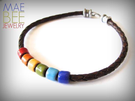 Enameled #rainbow beads on brown leather #bracelet from JewelryByMaeBee on #Etsy. www.jewelrybymaeb...