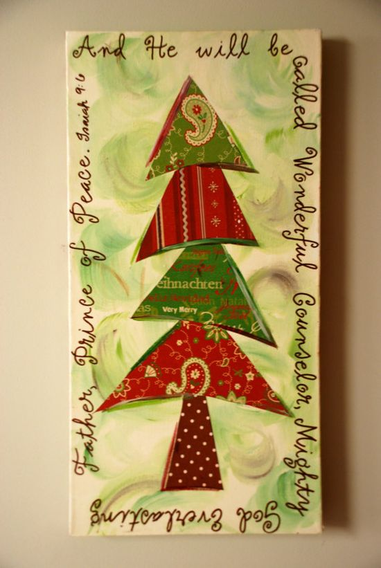 A Christmas canvas with a tree made out in various Christmas scrapbook papers.