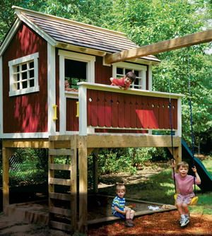 Elevated playhouse with a sandbox. My husband made this for our two girls.  He modified it by installing another beam for on the other side of the house for trapeze swing, rings and a tire swing.