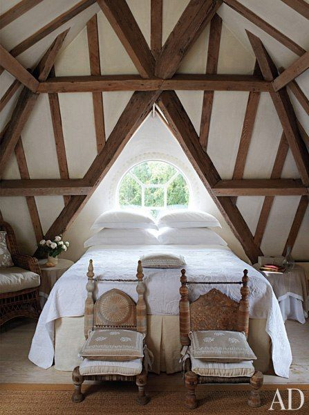 American-oak beams crisscross the ceiling in the top-floor guest room of an English country house.