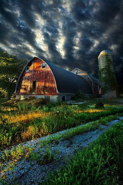 Beautiful clouds over barn