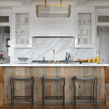 The contrast of the wood with the beautiful white walls is so wonderful! And look at that brass faucet hardware!