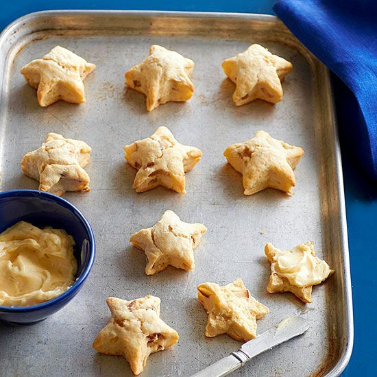 These Ginger-Pear Star Scones get a boost of flavor from homemade spiced butter made with crystallized ginger. More festive 4th of July desserts: www.bhg.com/...