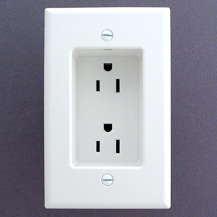 Note to self...if you ever build or remodel - use recessed outlets so that the plugs dont stick out from the wall. This allows furniture to be flat against the wall.
