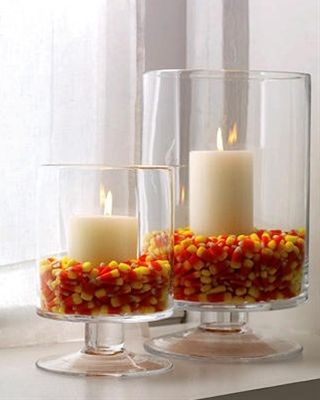 A great way to look the season and not eat all that candy corn, at least you won't if it has wax all over it right :) ___ I need to fill our antique mason canisters with candy corn!  Too cute!