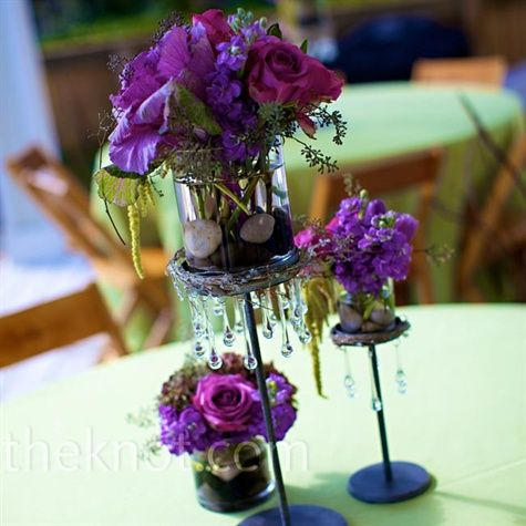 Table Arrangements.  Use Just For Flowers to make the roses are really deep purple/blue.