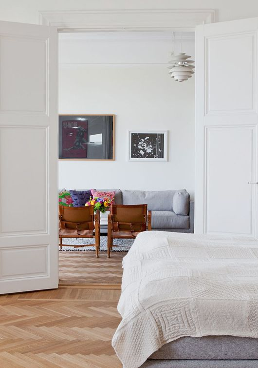 double doors off the living space into a bedroom makes space feel bigger