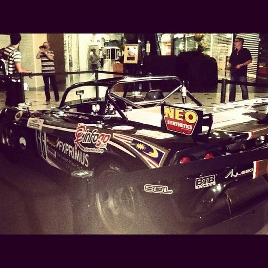 F1 racing exhibit on Lotus sports car.