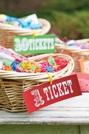 Set up a prize stand for kids to exchange their hard-earned tickets for trinkets and treasures. Place prizes from the dollar store in baskets, and label them according to their worth in tickets.