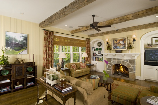 stone fireplace, beams, built ins, furniture arrangement