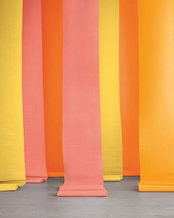 Would you believe this vibrant display cost less than $10? It's made from unfurled rolls of Paper Mart crepe paper, which is, insanely affordable and light enough to hang from the ceiling with painters' tape. It also comes in 34 hues.