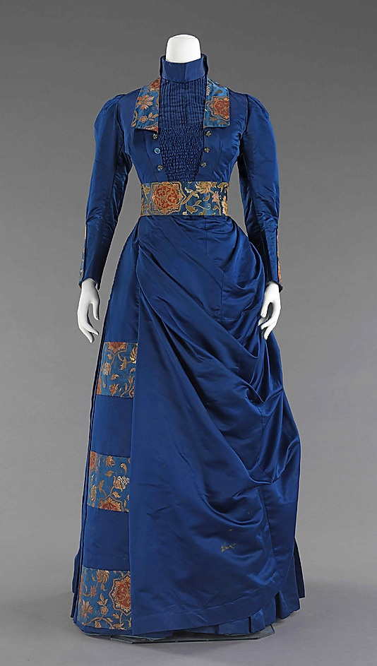 29-10-11  1885-88 Afternoon dress, blue with floral accents.