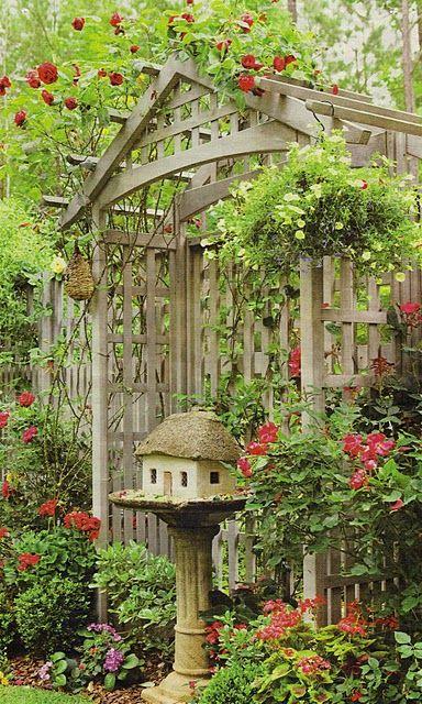 Birdhouse inside birdbath