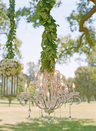 chandeliers strung from the trees  Photography by www.delesieblog.com/, Design and production by lisavorceohc.squa..., Florals and Event Design by mindyrice.com/