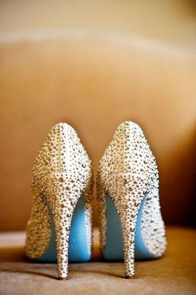 Wedding shoes. Blue bottom Louboutins. Something blue.