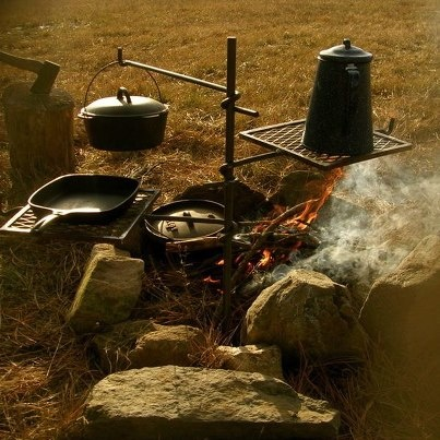 I want a campfire cooking station like this!