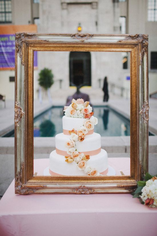 I like the frame, but it'd be prettier if the cake was higher up on a pretty cake stand..